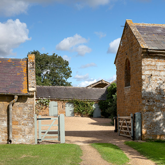 Large farmhouse with stables promoting household insurance in hexham