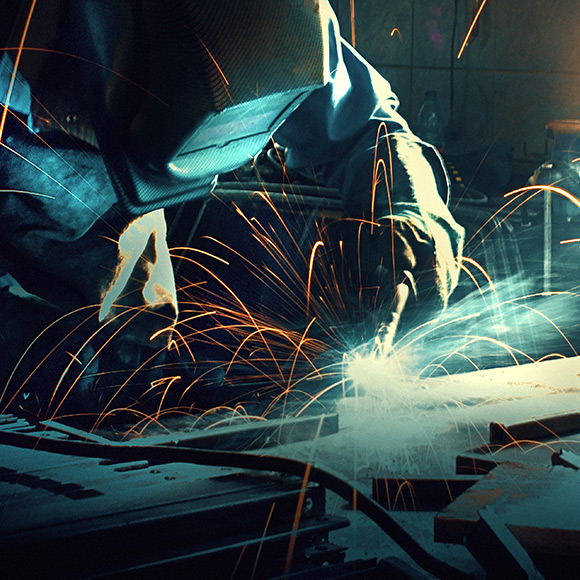 Welder working on metal promoting Public and Employers Liability insurance in Hexham