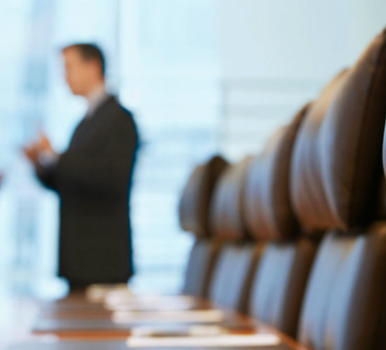 Blurred image of board members talking in a meeting room promoting Tynedale Insurance Broker's blog